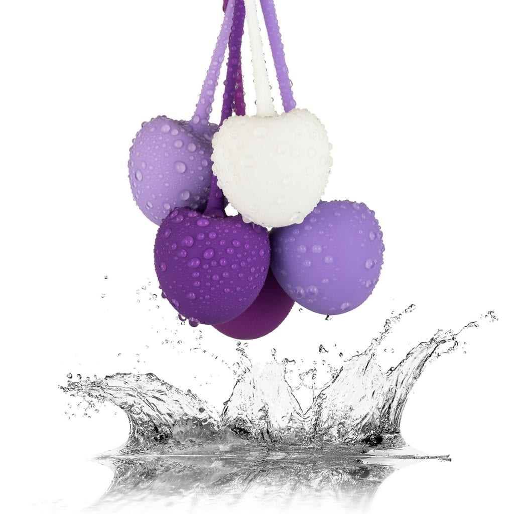 Kegle balls over a white reflective splash of water, creative product photography at its most complex.