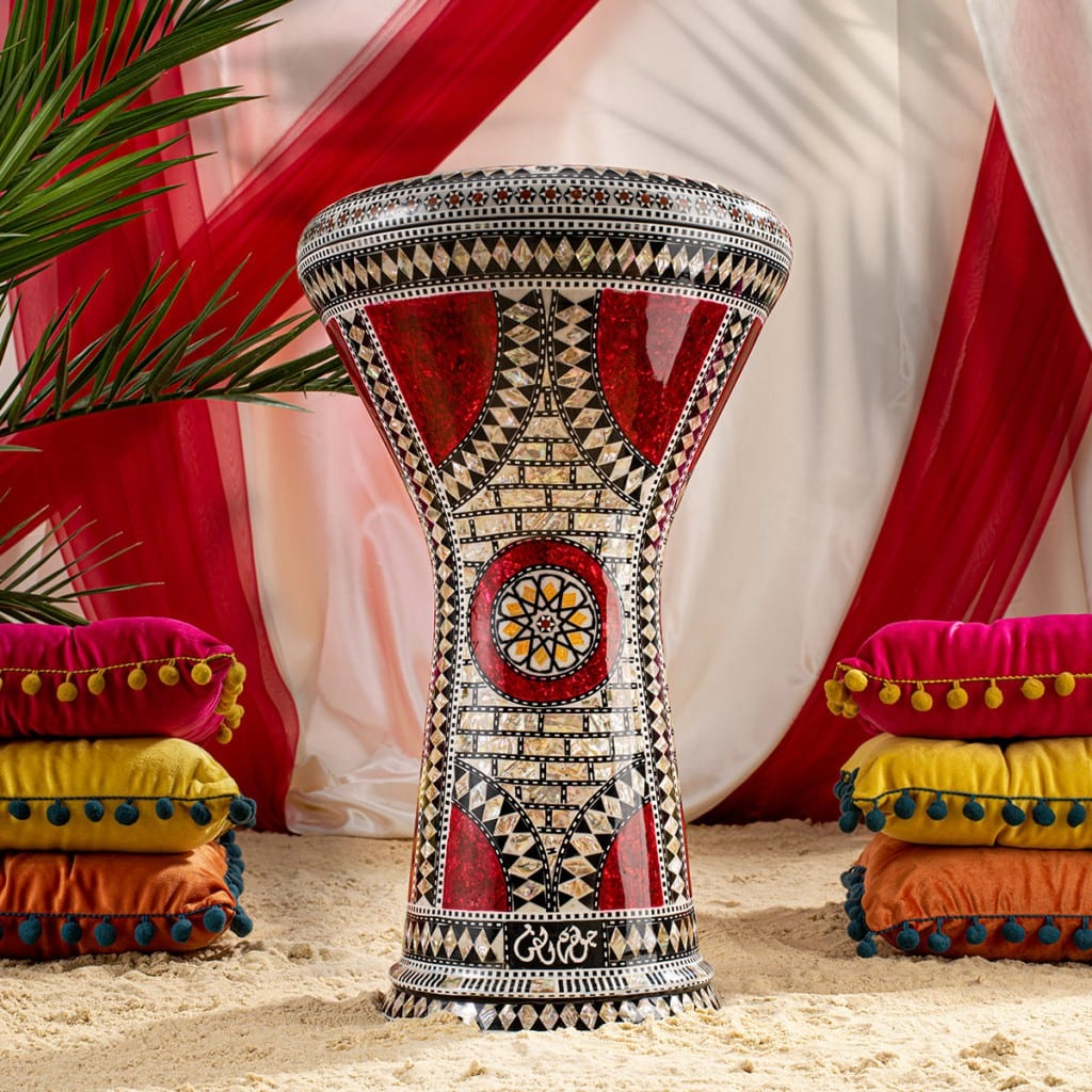 Product photography showing moroccan drums on a sandy creative background