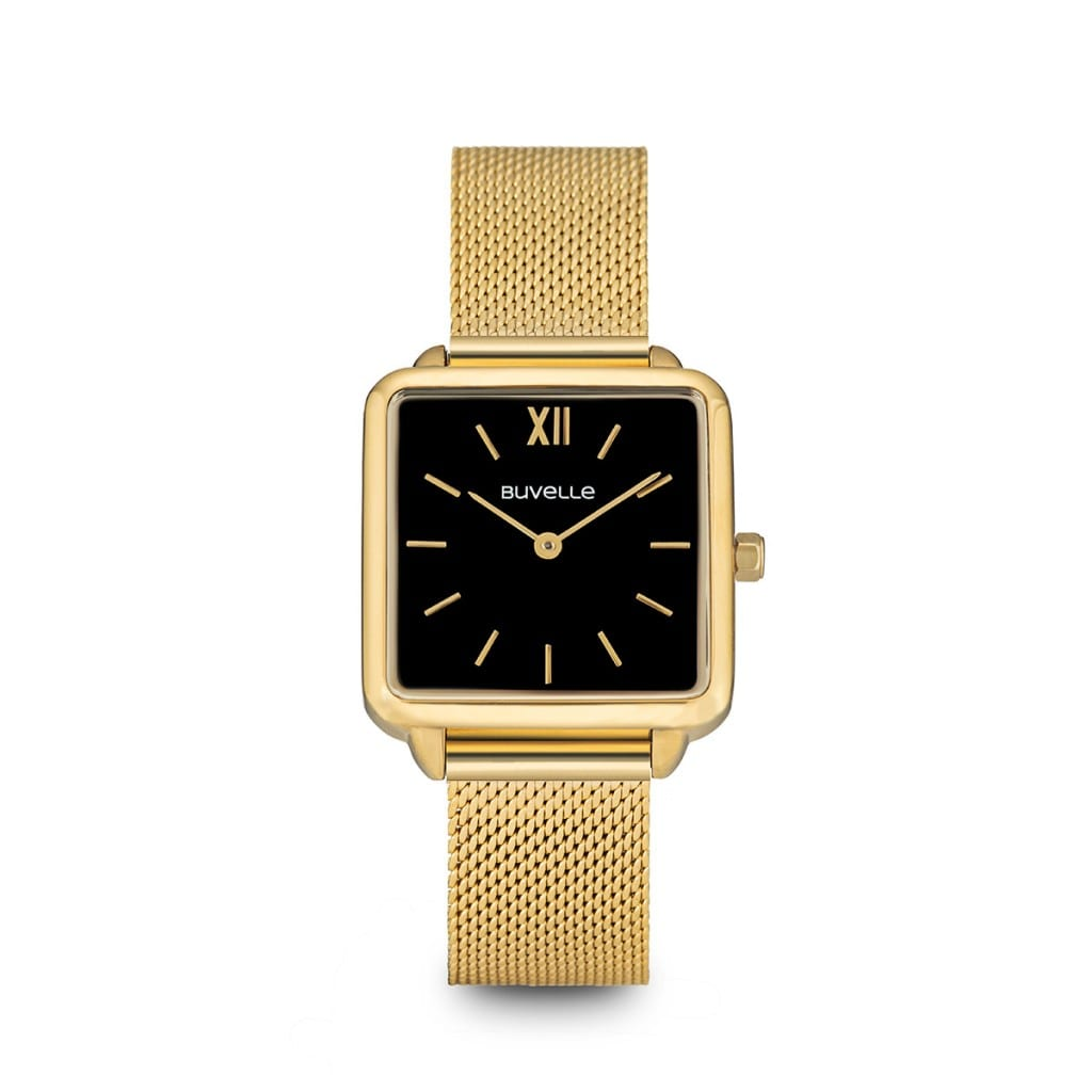 Gold watch with a square black face with gold details, showing product photography.