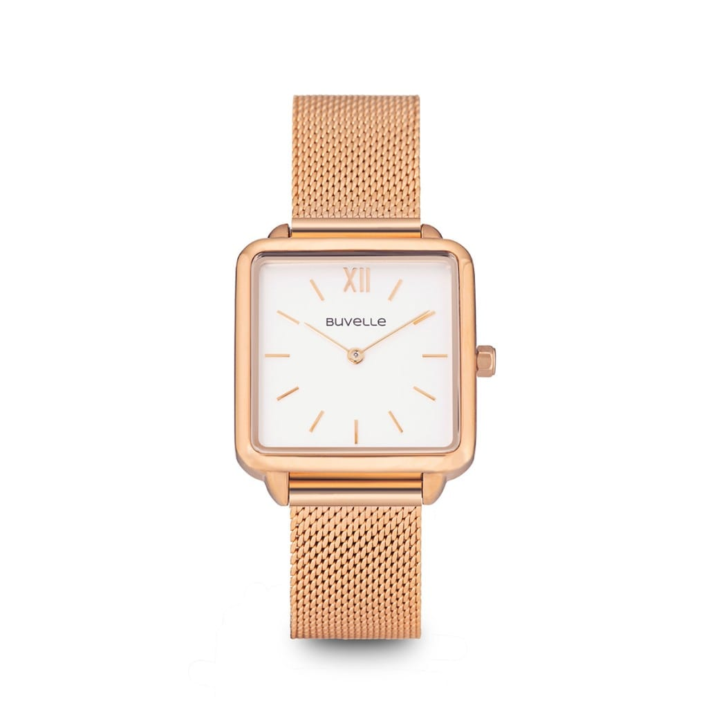 Rose gold watch with square white face with gold details, showing product photography.