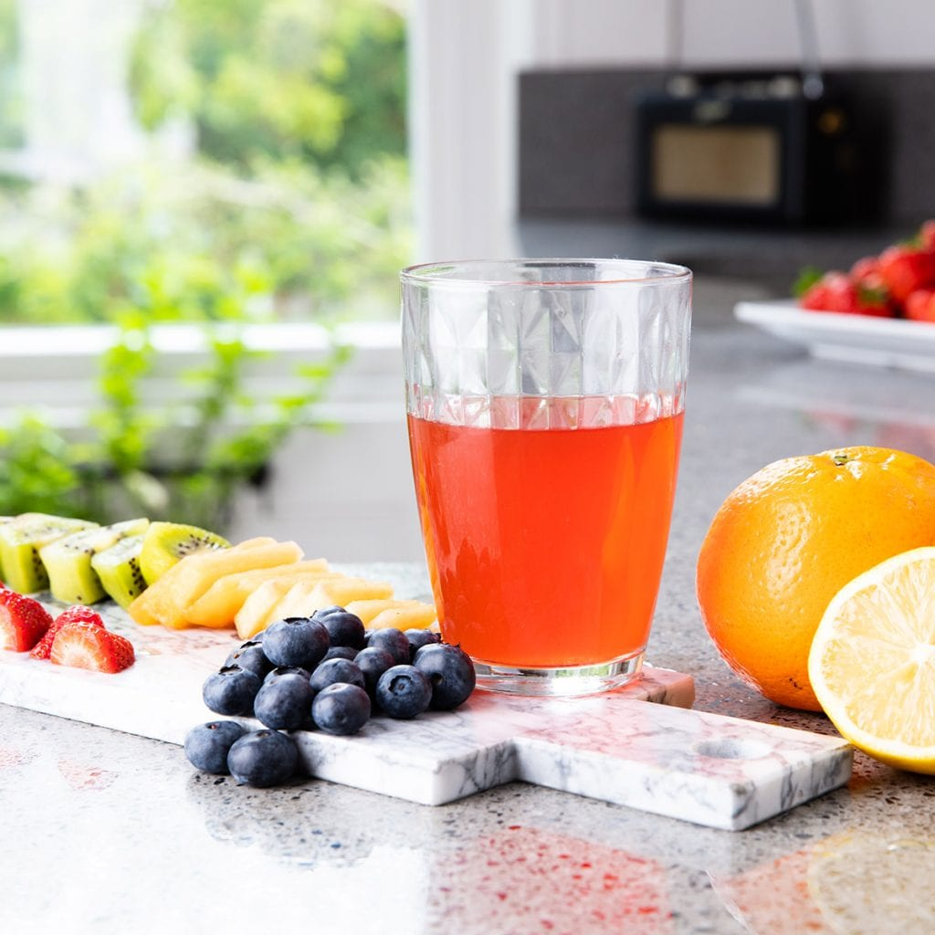 Lifestyle shot in a kitchen of a drink and fruit showing Lifestyle Product Photography