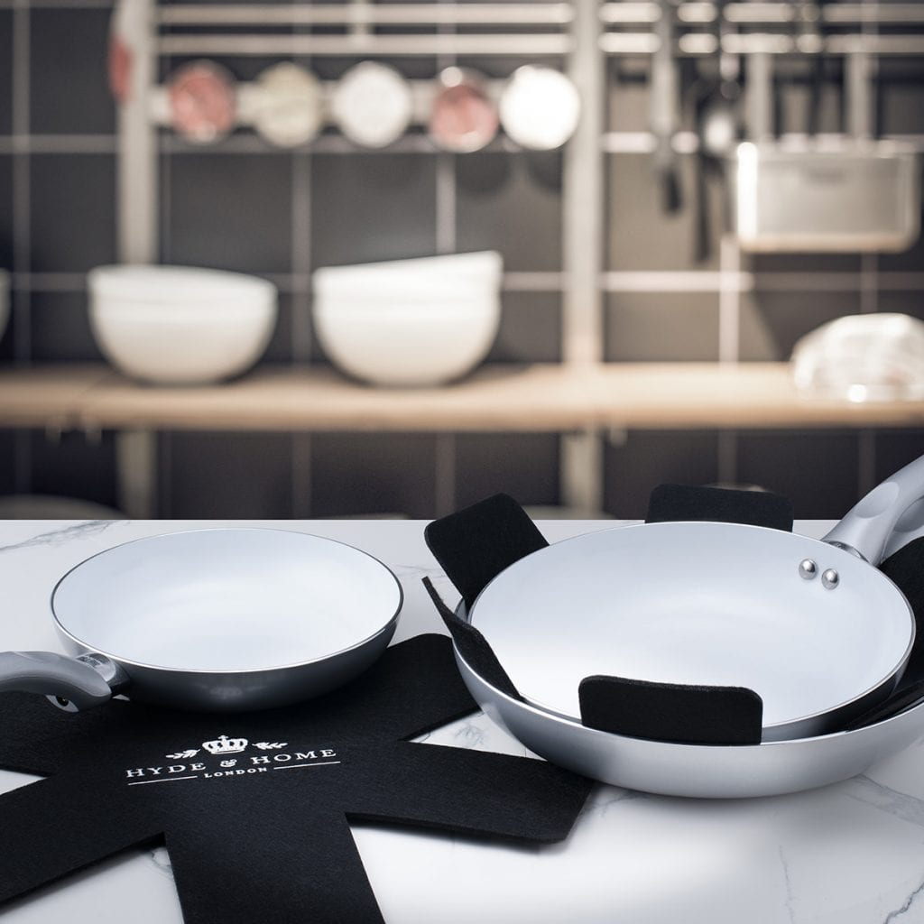 Pan stacking protectors in a kitchen, lifestyle product photography.