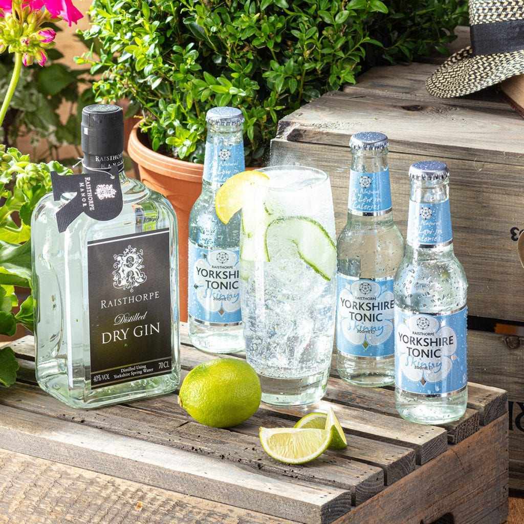 A lifestyle shot in the garden of Gin and Tonic, product photography.