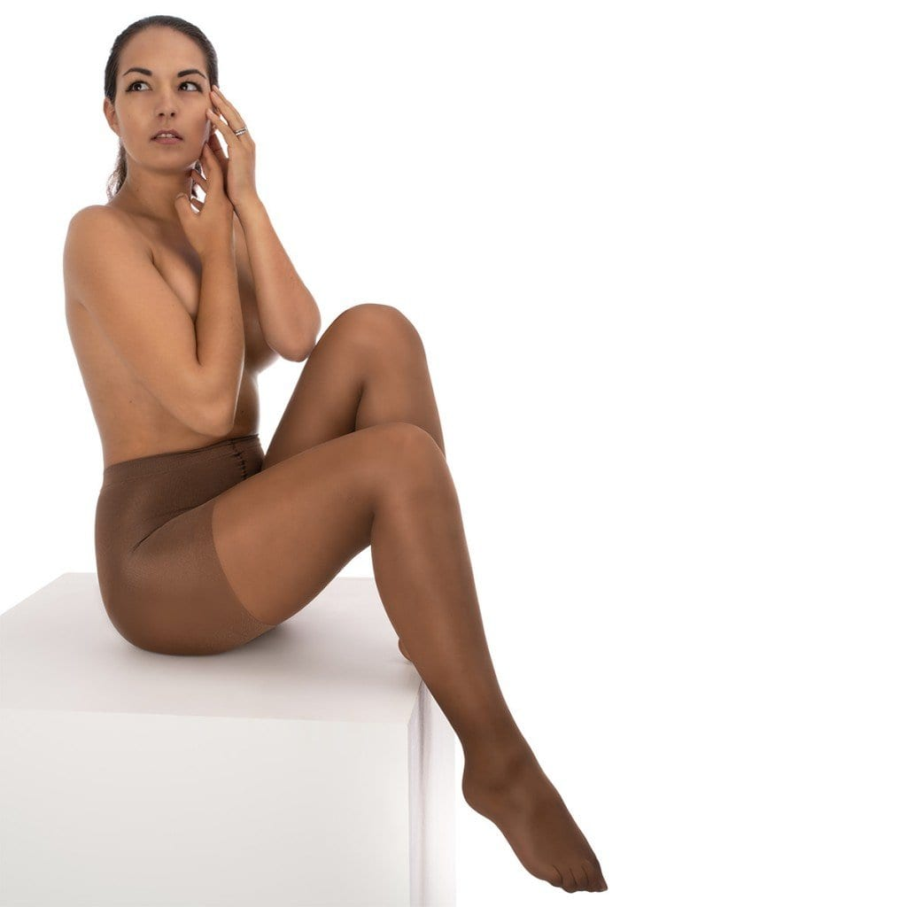 Model on a white background and box showcasing nude tights, doing clothing product photography.