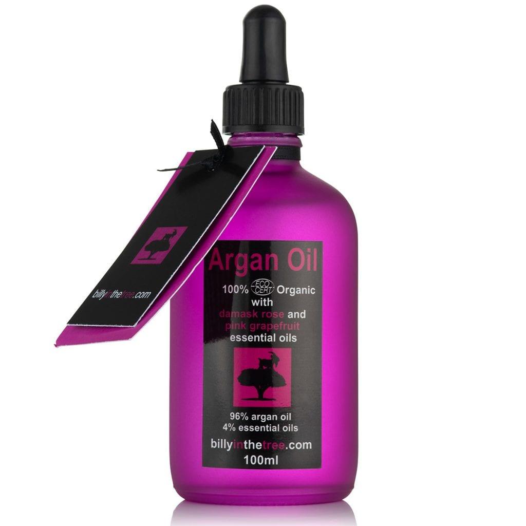 Packshot product photo of a purple bottle of argan oil.