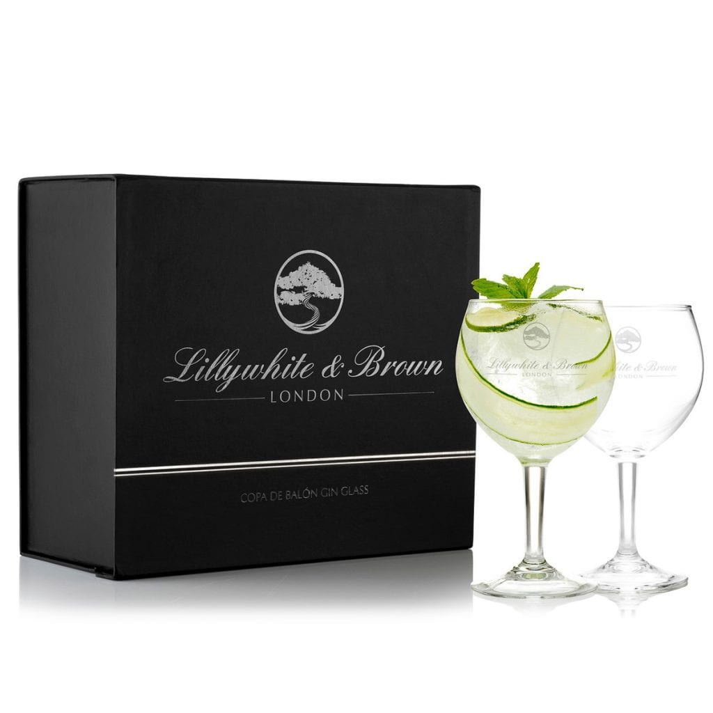 Reflectie glass gin bottles next to a black presentation box with silver writing, showcasing reflective product photography.