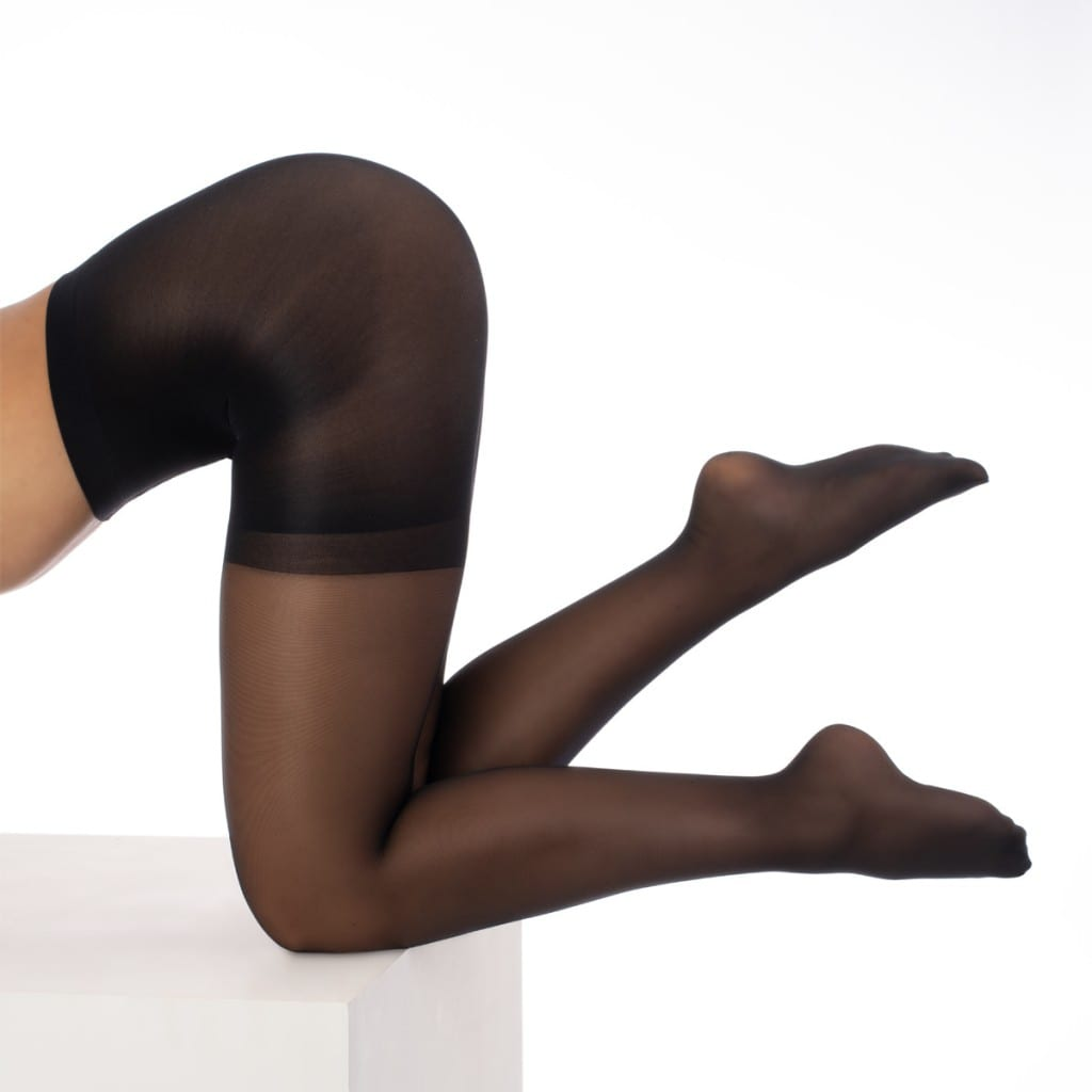 Clothing model product photography of black translucent tights.